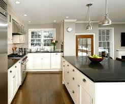 white kitchen with black island white kitchen island with black granite top great home interior