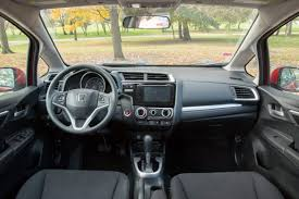 nissan versa interior subcompact hatchback head to head honda fit and nissan versa note
