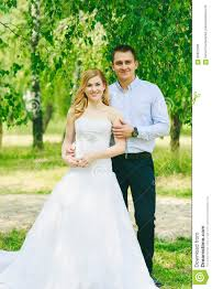 just married loving hipster couple in wedding dress and suit on