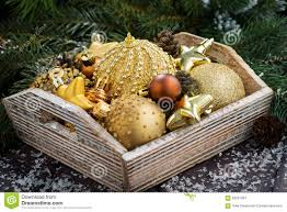wooden box with golden christmas decorations on table stock photo