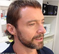 hugh jackman reveals his new mullet hairstyle on the set of his