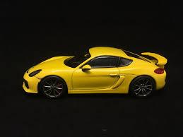 porsche cayman yellow porsche cayman gt4 yellow 1 43 schuco wap0204020f selection rs