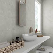 grey bathroom wall tiles with a beautiful travertine effect