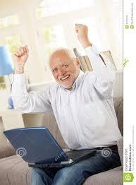 Old Guy Meme - happy old man sitting on sofa with laptop stock photo image of