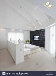 photo album collection bed with tv built in all can download all stock photo white attic bedroom with double bed and builtin tv in modern villa giv