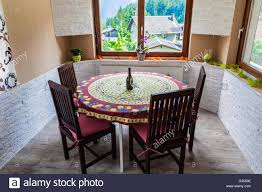 Cozy Dining Room A Cozy Dining Room With A Table And Two Glasses Of Whine And A