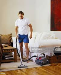 man vacuuming stock photo getty images