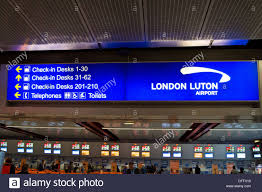 check in desk sign a luton airport sign showing where to go for the check in desks