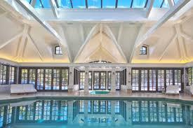 elegant private indoor glass mosaic swimming pool with atrium