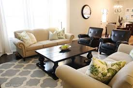 living room area rug placement white bedding rattan chairs white