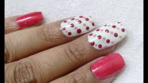 simple easy nail art with making dots of dark colour and same