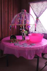 zebra print baby shower umbrella decorated with baby things for
