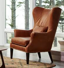 contemporary wing chairs clinton modern wingback italian leather chair with nailheads