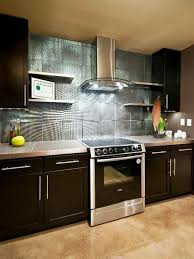 modern green kitchen black iron gas stove black shiny backsplash dark countertops white