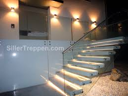 straight staircase concrete steps glass frame without risers