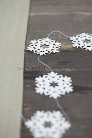 ib laursen paper cut on a string snow crystal