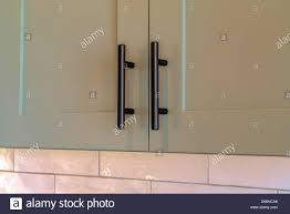 contemporary kitchen cupboard door handles cupboard handles high resolution stock photography and