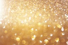 glitter vintage lights background light gold and black defocused