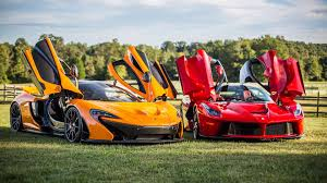 orange ferrari red ferrari laferrari and orange mclaren on the lawn wallpapers