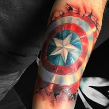 captain america shield tattoo done by carolyn elaine marvel