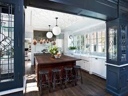 limestone countertops dark blue kitchen cabinets lighting flooring