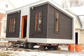 the tiny house u0027s exterior is finished with white cedar siding