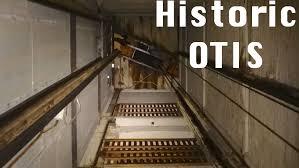 elevatour of habitat store w historic otis elevator wood rails