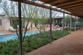 inside out ranch murphy mears architects pool in brick paver courtyard with desert landscaping surrounded by galvanized steel and wood covered walkway