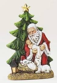 santa and baby jesus kneeling santa holding baby jesus catholic books crucifixes
