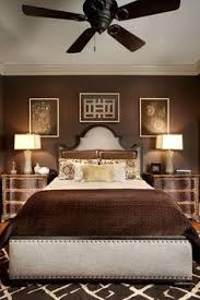Brown Bedroom Decor A Warm And Cozy Bedroom With Dark Hardwood Floors And Brown Paint