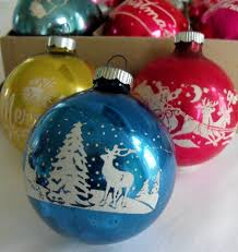 i still use our vintage ornaments on the tree each year along