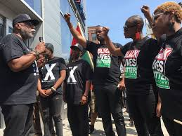 black power marchers shut harlem businesses for malcolm x day
