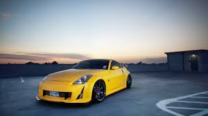 nissan yellow 2560x1440 yellow nissan 350z on rooftop desktop pc and mac wallpaper