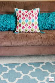 how to add an affordable new look to your home with pillows