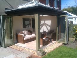 Wooden Bifold Patio Doors by Cottage House Design With Wooden Frame Bifold Glass Door In Brown