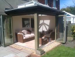 steel frame glass doors cottage house design with wooden frame bifold glass door in brown