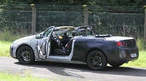 opel convertible 2013 opel astra convertible spied with the roof down