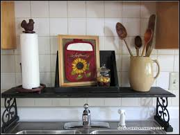 Kitchen Sink Shelves - organized clutter framing a potholder