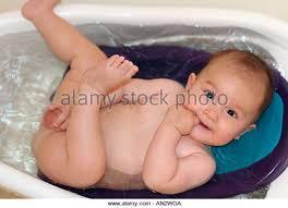 asian baby boy enjoy bathing stock photos asian baby boy enjoy