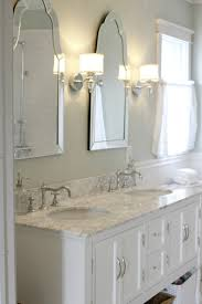 bathroom with arched framed mirrors home