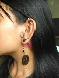 cool earring industrial piercing and lobe piercing with peace earring