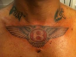 awesome bentley logo tattoo on biceps by angel bustos