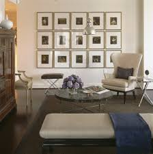 gallery wall gold frames living room contemporary with window