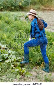 woman digging the ground with a shovel on a close up of a garden
