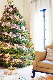 christmas trees are decorated with flowers instead of ornaments