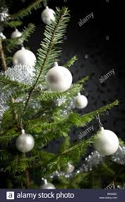 silver decorated fir tree with balls and chains black