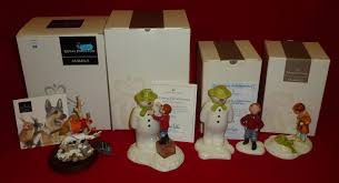 three royal doulton the snowman ornaments builds a