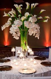 wedding flowers centerpieces balance of flowers in the middle but also room for lots of