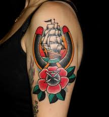 traditional horseshoe with ship and rose tattoo on left half sleeve