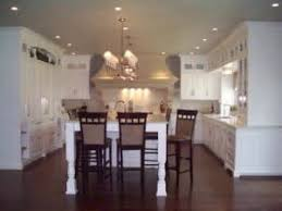kitchen cabinets with floors is it better to install hardwood floors before or after the